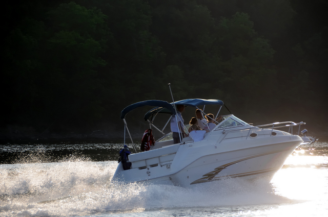 Speed Boating At Sunset